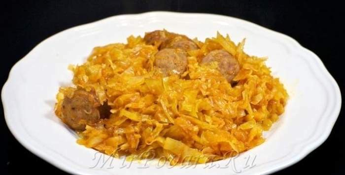 Рецепт Тушеная капуста с сосисками шаг-7